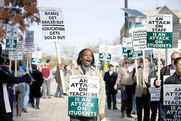 Unions and students picketing on Kennedy Boulevard.